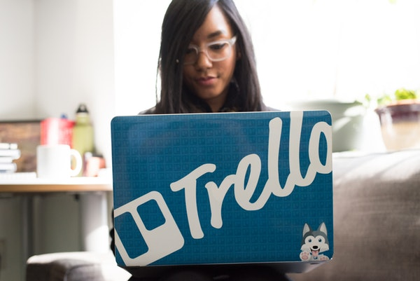 girl is using a laptop with trello laptop cover
