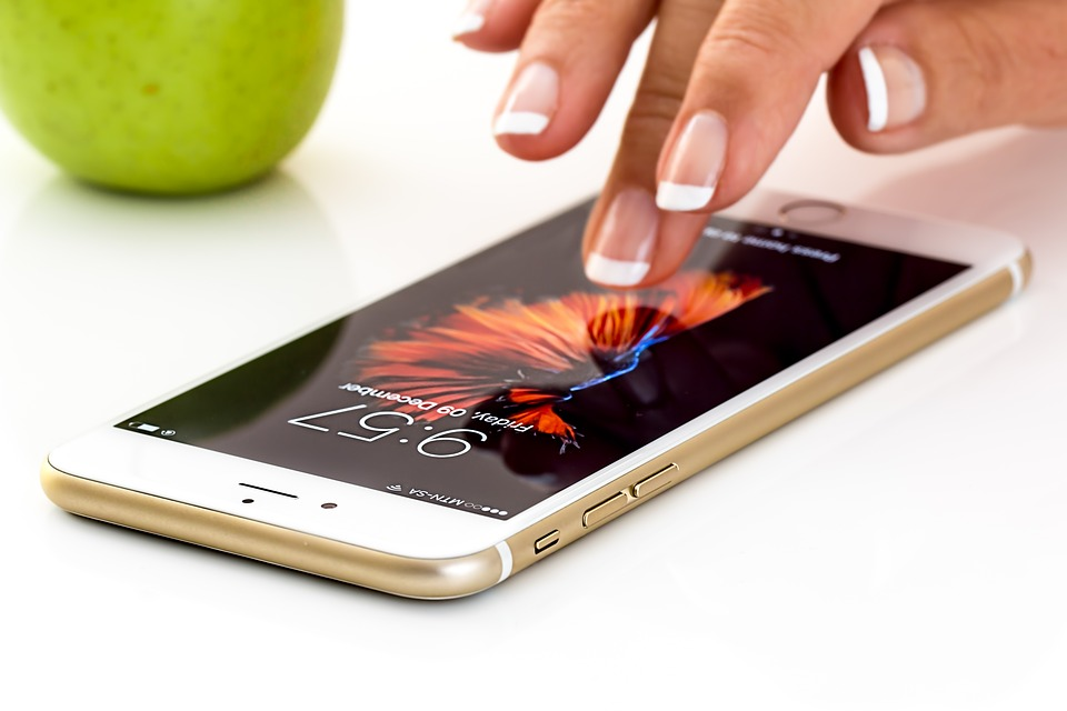 woman's finger touching smartphone