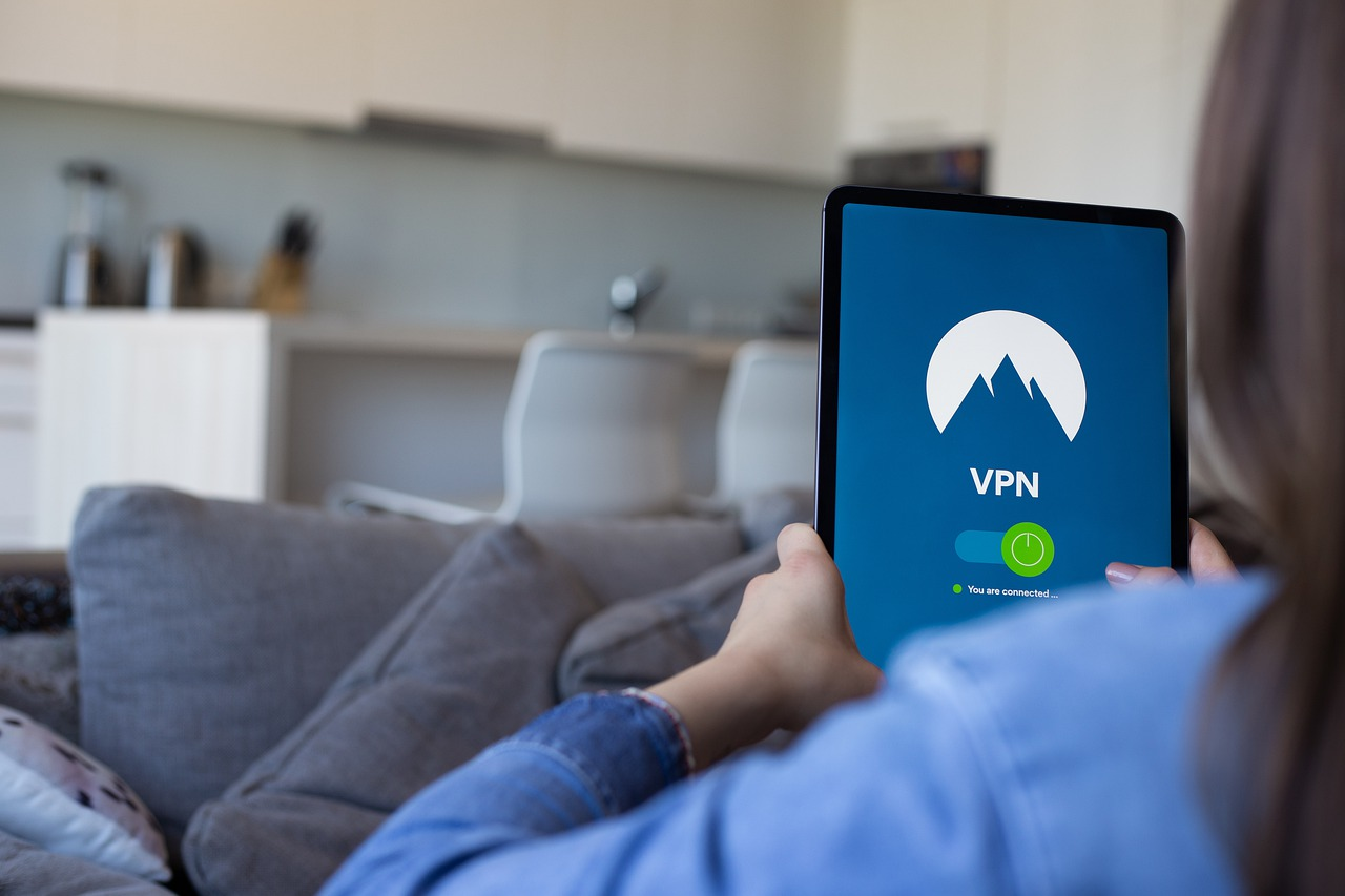 Woman using a tablet with expressVPN vs nordvpn